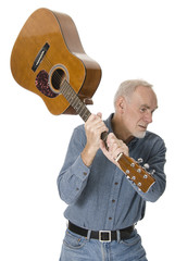 Old man about to destroy guitar