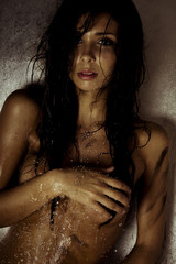 sexy model with wet and dirty skin
