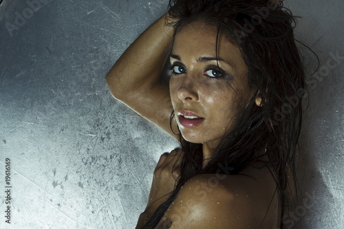 sexy model with wet skin and hair