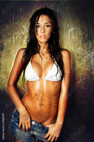 portrait of dirty sexy woman with bikini and wet hair