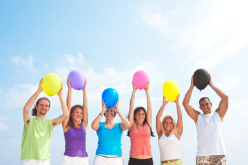 people with balloons in many colors