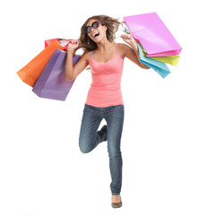 Happy shopping woman running