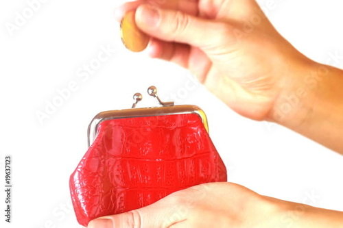 Hand insert coin in the purse and show thumb up sign