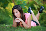 Cleavage - Busty young woman laydown in spring grass