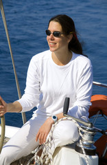 Young woman on a sailing yacht