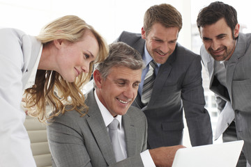 Business people looking at a computer screen