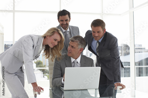 Businessteam with a laptop