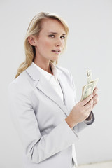 Woman with dollar notes