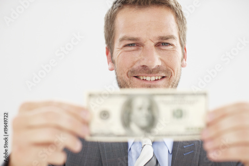 Happy man with a banknote