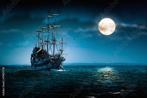 Leinwandbild Motiv Old pirate ship Flying Dutchman sailing to the moon