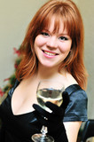 redheaded girl with glass of wine