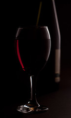 red wine with bottle in background