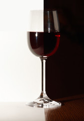 Wineglass of red wine.