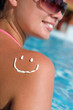 A smile made with suncream at the shoulder (shallow dof)