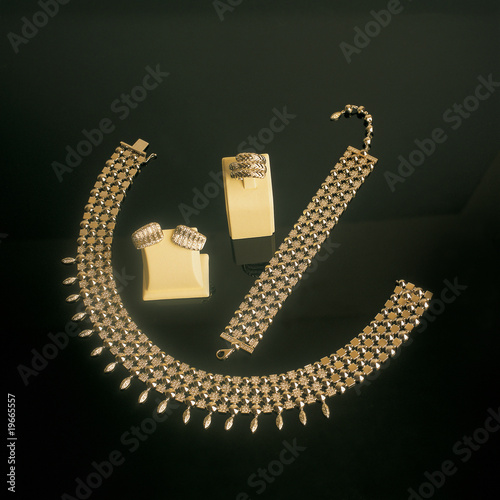 close up shot of gold jewelry on black