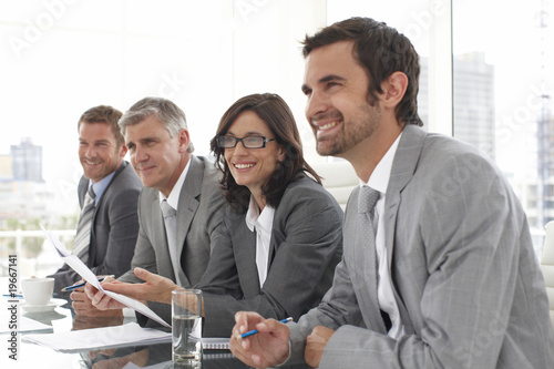 Businesspeople listening to a candidate