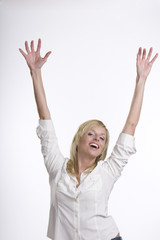 Businesswoman showing joy, both arms up, isolated on white. .Mat