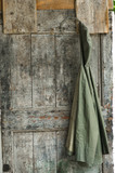 Jacket hanging on an old wooden door