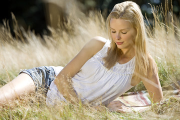 A young woman lying on the grass, relaxing