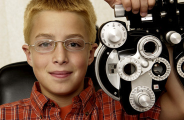 Boy getting eye exam