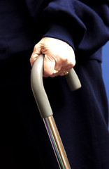 Womans hands on cane