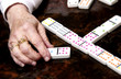Woman playing dominoes