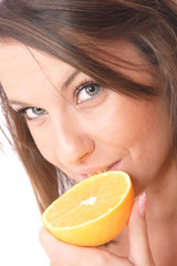 happy model eating an orange