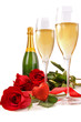 Champagne glasses with red roses and little heart
