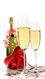Glasses of champagne with red ribbon heart