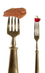 Two fork with bacon and pepper.