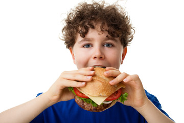 Boy eating big sandwich isolated on white background