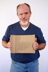 Man holding up square blank piece of cardboard.
