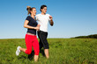 Young sport couple jogging outdoors in summer