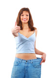 Happy young woman in old jeans pant after losing weight. poster