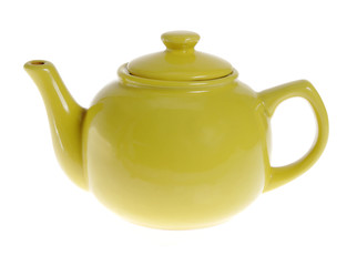Yellow teapot on the white background