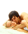 Intimate couple enjoying sexual intercourse on the bed.