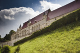 episcopal palace in laon with green grass and clouds
