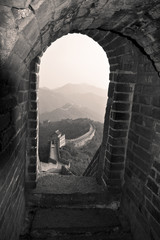 View of the Great Wall of China from inside an archway.