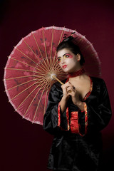 Sexy japanese geisha looking sideways