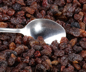 raisin background and teaspoon