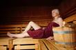 Leinwanddruck Bild - Junge Frau in der Sauna