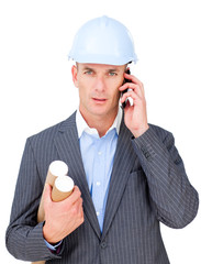 Stressed male engineer talking on phone