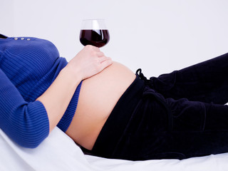 glass of wine on the stomach
