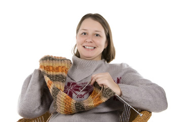 girl shows a knitted scarf