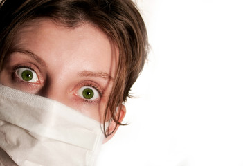 Woman wearing medical mask protecting against flu virus