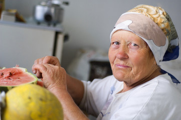 old woman eating a watermelon