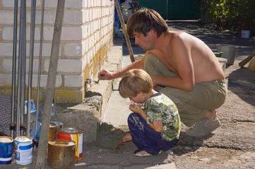 dad and son make renovation outdoor