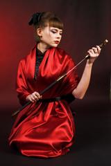 girl in red kimono with katana