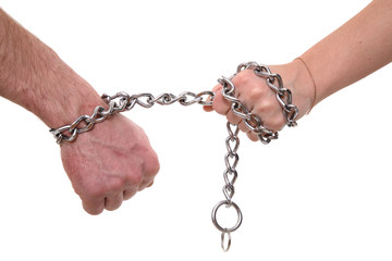 The female hand pulls a man's hand for a chain