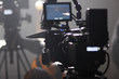 Leinwanddruck Bild - Digital cinema camera on a foggy/smoky movie set